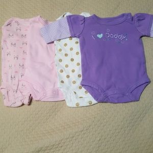 Four long sleeved Carter's Newborn onsies